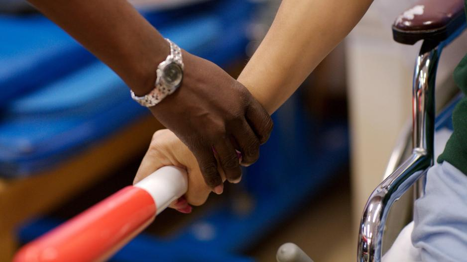 closeup on occupational therapist's hand working with a client