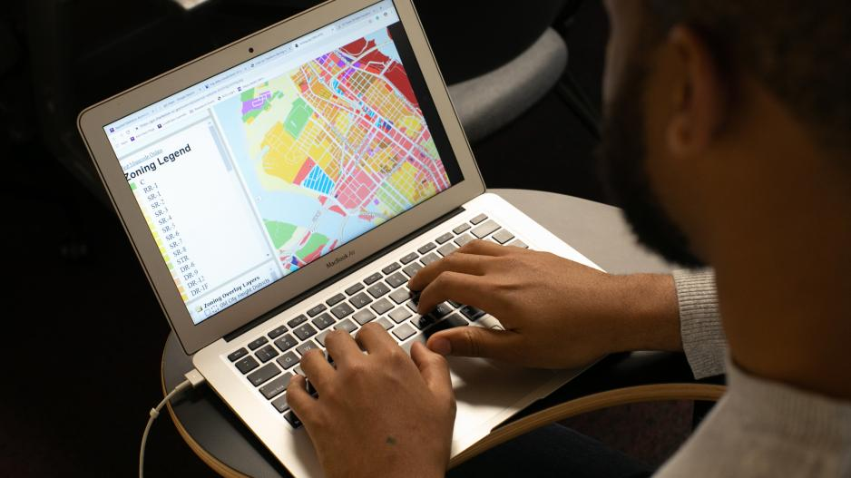 A statistician looking at a map on his computer