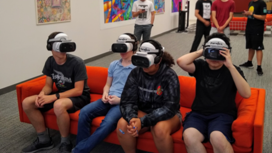 High School Students Wearing VR Goggles