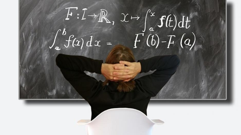 Woman looking at calculus equations