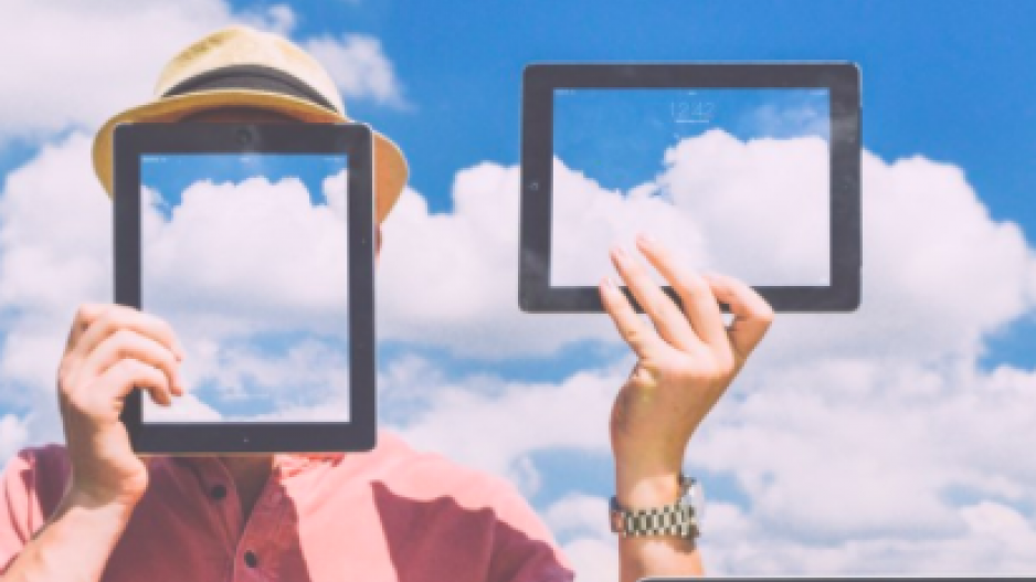 Figure with cloud computer frame in front of face.