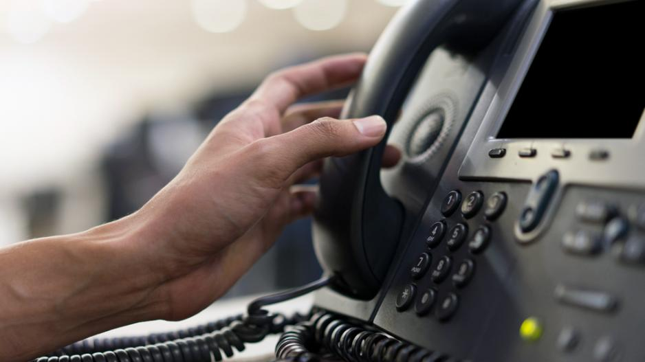 A closeup image of an office telephone