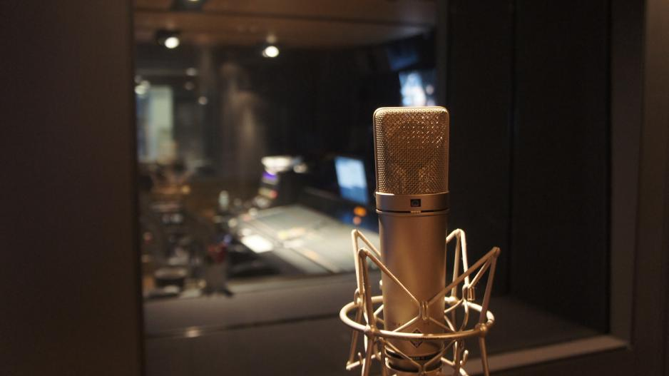 Microphone with the Dolan Studio control room in the background