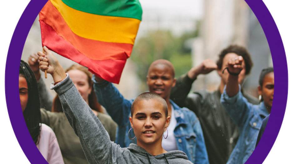young people marching and waving rainbow flag