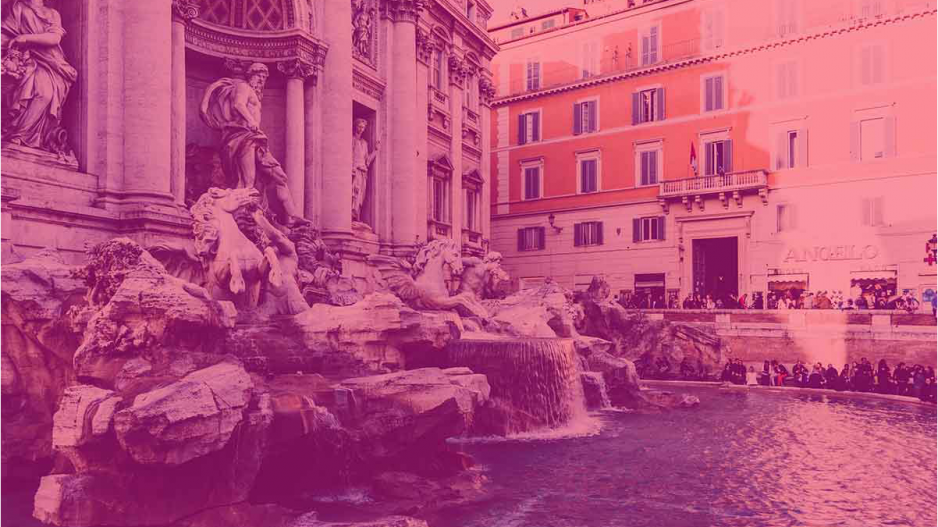 An image of a fountain with a pink filter over it.
