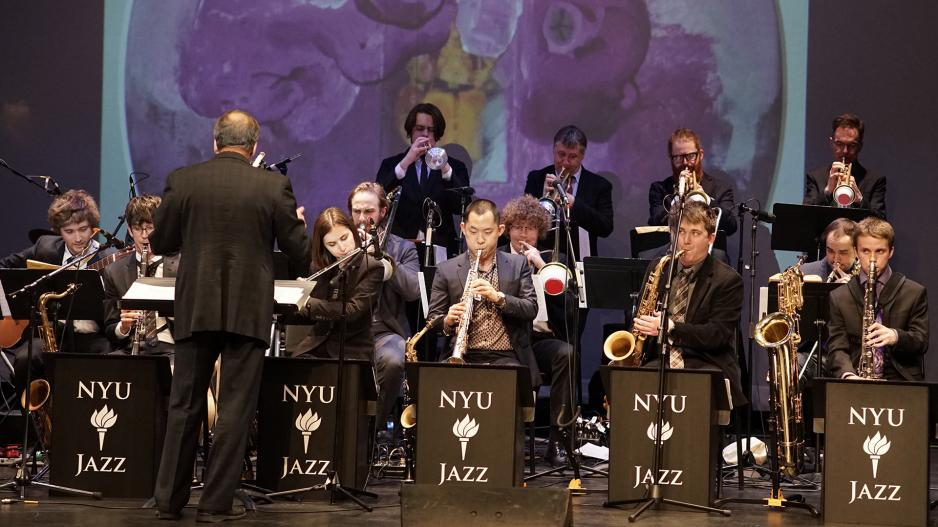 A picture of a group of NYU Jazz ensemble performing at a conservatory.
