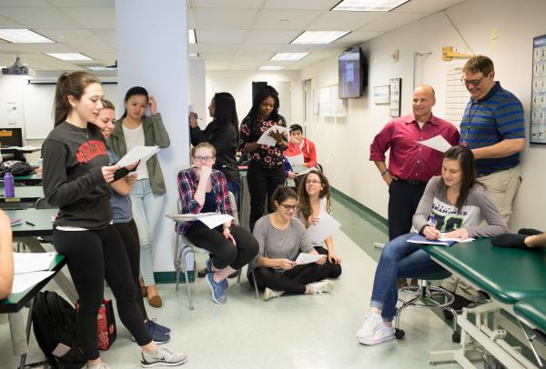 Physical therapy students attend a class lecture