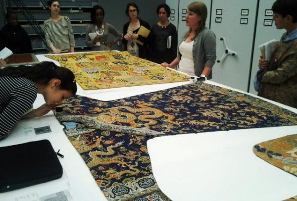 students examining fabric
