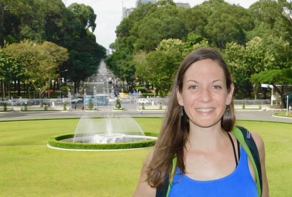 International Education doctoral student Amanda Blewitt in front of a fountain