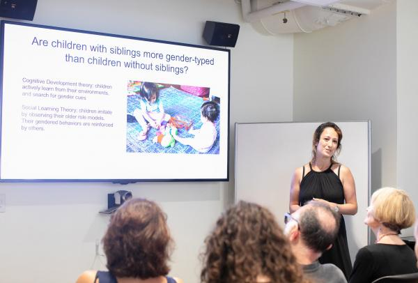 Woman presenting powerpoint in front of group