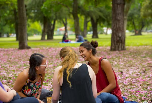 Students laughing in the park