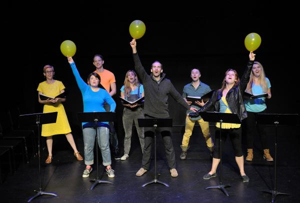 performance from new plays for young audiences - performers holding balloons
