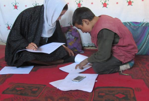 A teacher helping a child with schoolwork