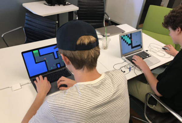 High School Students Designing Games on Laptops
