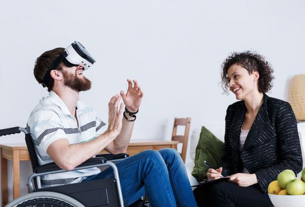 Man in wheelchair with virtual reality headset